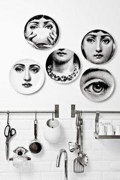 Create a unique shape starting at the center: http://www.stylemepretty.com/living/2015/03/01/statement-plate-wall/