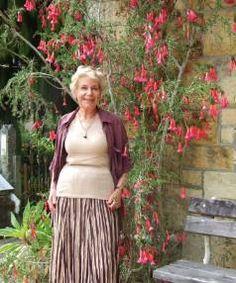 Margaret with her carmine-coloured Cantua buxifolia