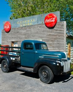 Antique Ford truck in front of an old general Store, Quebec, Canada.