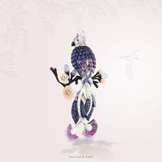 """""""An exercise in style"""" by Van Cleef & Arpels - Creation.  Constantly renewed, Van Cleef & Arpels' craftmanship has always been instilled with passion, inspiration and poetry. Perroquet mystérieux clip, 2011 - white gold, red gold, colored sapphires, onyx, chalcedony, pink opal, black spinels, Mystery-Set™ colored sapphires and diamonds. #HighJewelry #AnExerciseinStyle"""