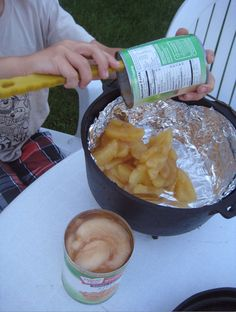 """Dutch ovens are great for making """"Dump Cakes,"""" meaning, you dump everything into the oven, close it up, and let it bake. My boys made their own Dump Cake during our weekend campout -- so simple and so delicious..."""