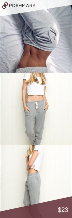 Brandy Melville Light Grey Sweatpants Brandy Melville Grey Sweatpants. Very worn. Not soft on the inside anymore. No holes or stains. Would best fit a size small. No trades. Ships within 2 days.   #brandymelville #sweatpants #greysweatpants Brandy Melville Pants Track Pants & Joggers