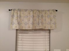 """This listing is for 1 valance in Waverly Circular Motion Sterling. The valance is lined with premium white lining to prevent fading. Product measures 50"""" wide x 20"""" long with 1.5"""" rod pocket and 1.5"""" ruffle top."""