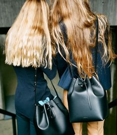 glossy long hair, black leather bags