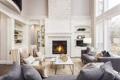 Beautiful living room interior with hardwood floors and fireplace in new luxury home. Large bank of windows hints at exterior view , Living Room Interior, Living Room Decor, Dining Room, Beautiful Living Rooms, Beautiful Family, Beautiful Space, Fireplace Design, Fireplace Brick, Fireplace Modern