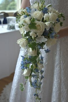 My bouquet: A cascading array of white roses, ivy, a mixture of different types of white and blue flowers, and white butterflies.