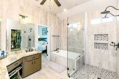Talk about a shower for days - I love the dual rain shower heads that have been popping up lately. Another deep luxurious bath as well with lots of counter space. Another beautiful #padreisland home! #listingfotos #bathroomdesign #realestate Interiors / Hospitality / Lifestyle / Real Estate photography at http://ift.tt/297bBJy