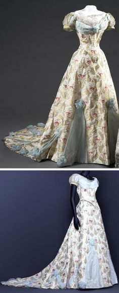 Dress, Augusta Lundin, Stockholm, 1905. White silk with silk floral brocade in gold, red, blue, white and purple. Made for Queen Victoria of Sweden (1862-1930). emuseumplus.se