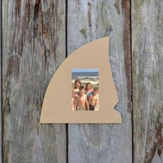 Unfinished shark fin picture frame, ready to be painted! Can be purchased at www.build-a-cross.com #buildacross #pictureframe #sharkfin #beachpictures #DIYprojects#giftideas