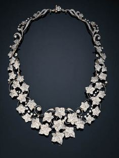 Antique diamond ivy necklace by Tiffany & Co. Tapering pav-set diamond ivy openwork collar, enhanced by diamond collets, mounted in platinum and gold (originally designed as a tiara), circa 1895. Christie's.