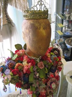 Vignettes Antiques: Sorciere Chic! Blank face gold painted mannequin head dressed in floral collar and tiara, - I have one of these heads - must try this idea!
