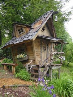 "•☆.•*Former Disney artist Arthur Millican Jr., maker of ""exciting fairy house manors"" built this excellent storybook style playhouse from found materials. It reminds me of the ""witch's house"" on Carmelita street here in Los Angeles.    If the storybook style appeals to you, here's a book about it that I like: Storybook Style: America's Whimsical Homes of the Twenties.    Whimsical Playhouse (Via Lloyd's Blog)   •☆.•*´¨`*••♥  ♥••*´¨`*•.☆•"