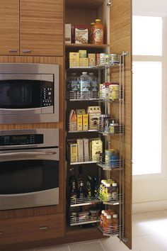 Our Tall Pantry Pullout Tandem Cabinet features door mounted wire shelving AND wire sliding shelves giving the ability to store items as you like.