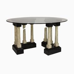 An unusual Italian dining table in the manner of Fornasetti depicting a pair of marble 'Roman Ruins' supporting a circular clear glass top. The marble is tiled and comprises a variegated dark green and cream marble. Antique Furniture, Modern Furniture, Glass Center, Italian Marble, Center Table, Vintage Italian, Glass Table, Clear Glass, Dining Table