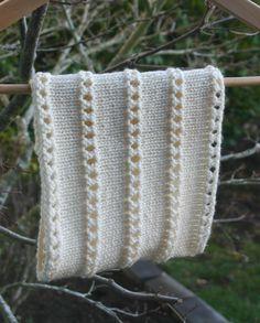 "Pattern: Stacked Eyelet Cowl by Ami Madison  Yarn: Rowan RYC Cashsoft DK in ""Cream"" Needle: Size 6 circ FROM http://knittymuggins.wordpress.com/"