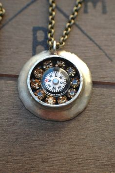 Unique necklace with handcrafted bezel and compass. Brass cable chain, swarovski crystal and champagne rhinestones.