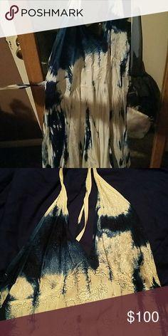 Nwt advance apparels dress Knee length, halter style dress. Never worn and light fabric size L/XL Dresses