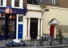 "Notting Hill Photograph 7. The Blue Door (William's Flat). Directions from The Travel Bookshop: Go back to Portobello Road and turn left. You will pass Saint's Tattoo Parlour at 201 Portobello Road where in the movie a drunken/confused man comes out with an ""I Love Ken"" tattoo and no recollection why. Westbourne Park Road is the next road that crosses Portobello Road. Turn left to 280 Westbourne Park Road. The first thing you'll notice is that there's no blue door (it's now black)."