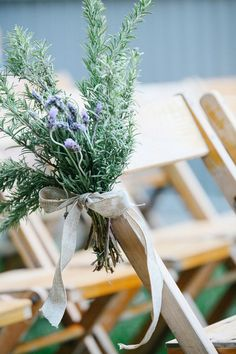 Unique, organic wedding ceremony aisle marker idea - fresh greenery with purple wildflowers tied with burlap ribbon {Leah Moyers Photography}