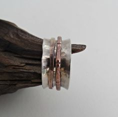 Hammered sterling with copper & bronze double spinner by RustyWing