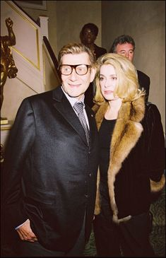 Pin for Later: On His Birthday, a Look Back at the Life of Yves Saint Laurent Yves Saint Laurent Yves Saint Laurent with Catherine Deneuve at the opening of the Yves Saint Laurent Foundation in Paris in March Catherine Deneuve, Yves Saint Laurent, Elsa Peretti, Carolina Herrera, Karl Lagerfeld, Cannes, Vogue, Valentino, Lesage