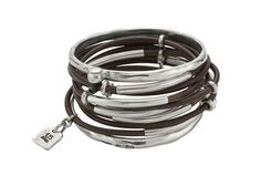 $165 Women's bracelet with superimposed leather strips, silver plated tubes and bangles http://us.unode50.com/en/shop/bracelets/2001
