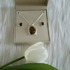Beautiful Necklace + Earing. Brand new. Beautiful Brand New Necklace + Earing.  Smoke and pet free home.  Happy Shopping. Accessories