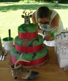 camo wedding cake, but with orange ribbon and minus the head on top...