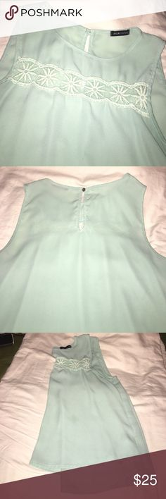 Teal flowy sleeveless shirt 4 small snags on front shown in picture 4. Lace on front shows skin. Super cute blouse!  Make me an offer! All pricing inquires must be made through the offer button! Tops Blouses