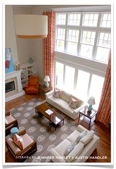 Orange as the accent color  also two story family room drapes