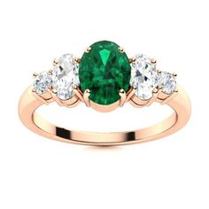A trio of precious twinkling oval gemstones symbolize the past, the present and the future in this 14k Rose Gold Emerald ring. Feel free to customize them in your birthstone along with that of your spouse and child! We only use Natural AAAA Emeralds which are the top 15% of all real / genuine Emeralds available. They are rich green, moderately to slightly included and exhibit high brilliance. This quality is typically used in fine jewelry by the 5th Avenue or Rodeo Drive Jewelers. Rose Gold Emerald Ring, Natural Emerald Rings, 5th Avenue, Love Ring, Emeralds, Rodeo, Exhibit, Vintage Rings, Ring Designs