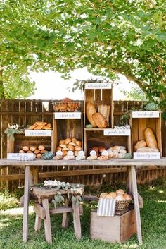 Rustic wedding bread station with croissants and artisan breads. Serve with flavored butter spreads