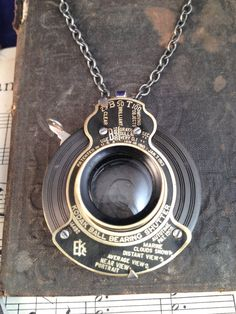 Working Antique Camera Shutter Pendant: Take a nostalgic trip back into the early days of photography when Kodak was expanding the photo