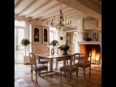 Stone floors, a roaring fire next to the dining room table and exposed beams. Yes, the French cottage charm comes alive with these grand, yet humble details. French Country Dining Room, French Country House, Country Chic, French Decor, French Country Decorating, Rustic French, Modern Rustic, Dining Room Design, Dining Room Table