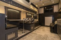 Living room area in a bus. Get your bus conversions done at Fox Trailer Servive