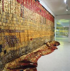 al anatsui - Every tapestry is made from tops of evaporated milk tins, rusty metal graters and old printing plates, liquor bottle caps, all gathered in and around Nsukka, Nigeria