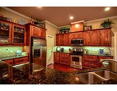 18248 Wigeon Trail Dr., College Station, TX Duck haven home sits on 1.13 wooded acres! The master retreat features a large bay window with an amazing view of the backyard and a door leading to the covered back patio. This split bedroom floor plan features 2 more bedrooms on the 1st floor with a jack and jill bathroom situated between them. The open concept living room is accented with granite counters, stained concrete floors and gorgeous cabinets. Amazing back patio! Realtor: Michelle…