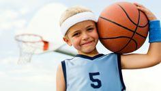 A kid playing basketball.