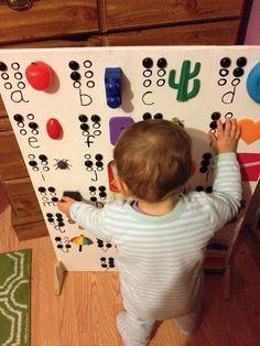A tactile braille alphabet board!