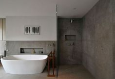 free standing tub, cement & glass door for shower