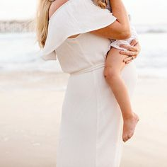 Give me a beautiful pregnant mama in a white flowing gown, her adorable side-kick, and the beach at sunset. ⠀ S W O O N ! !⠀ .⠀ I had so much fun romping around the beach with Carlie, her daughter, and pup! I'm in love with the collection that came out of our time together. It was beautiful to see this pair's mother-daughter bond, and excitement for the arrival of their baby. The world as they know it is about to grow in an awesome way. I can't wait for them to meet their newest love!!  ⠀ .⠀…