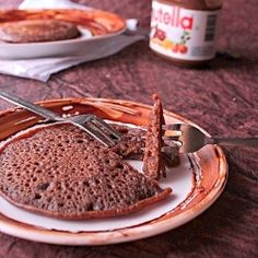 Eggless Nutella pancakes- 1 c. flour, 1/2 c. milk, 1/4 c. sugar, 2 T. Nutella, 1/4 c. buttermilk, pinch of baking soda