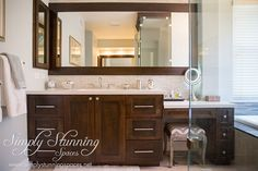 Simply Stunning Spaces bathroom design. These dark wood cabinets are the perfect accent for light and bright walls, white counter tops, and a textured backdrop.  For more interior design inspiration visit: http://simplystunningspaces.com/