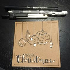 handmade Christmas card ... kraft base ...  looks like hand lettering and drawing in black with white accents ... like the rustic look ... perfect masculine look too ...