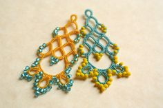 Delicate tatted lace earrings, perfect accessory for your daily outfit as well as stylish addition to an elegant dress or bridesmaids gift  I tatted these drop earrings with high quality polyester thread and matching seed beads. Choose your favorite colors from the drop down menu  Tatting is a technique for handcrafting a particularly durable lace constructed by a series of knots and loops.The filigree tatting lace makes these statement earrings very light and so comfy to wear despite their…