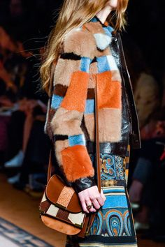 The '70s are alive and well, but last season's proliferation of fringe bags may very well be replaced by the leather patchwork cross body bags at Etro's boho chic collection.