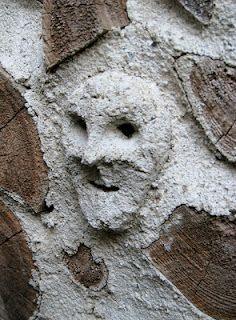 Incense-burner guy lurking on a cordwood masonry wall