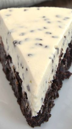 Chocolate Chip Cheesecake with Brownie Crust Recipe ~ Two desserts in one is always a win! Chocolate Chip Cheesecake with Brownie Crust combines brownies and cheesecake for a delightful dessert experience