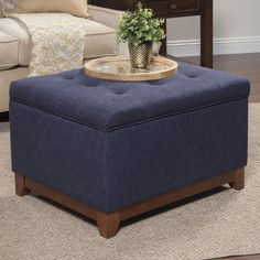 Invite upscale elegance into your home with this beautiful fabric ottoman. The woven fabric features button tufting offset with light finished wooden legs. Best of all, storage room inside makes this an attractive option for bedrooms and small spaces. Square Storage Ottoman, Tufted Storage Ottoman, Linen Storage, Extra Storage, Fabric Ottoman, Storage Room, Food Storage, Storage Ottoman Coffee Table, Ottoman Table