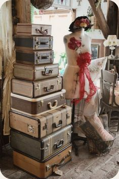 I love the look of vintage suitcases, and the idea of stacking them (in a corner as art, or as a nightstand, etc)... but every vintage suitcase I've ever seen in person smells of mildew.  Anyone have any ideas for getting rid of mold/mildew in something like this?  I have allergies, so I'd need to solve the problem, not just 'mask' it.